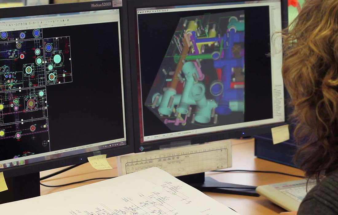 Engineer working with 3D programm for manifold blocks