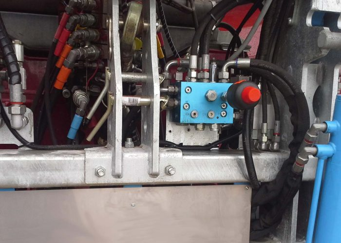 Close up of a hydraulic system on an agricultural machine